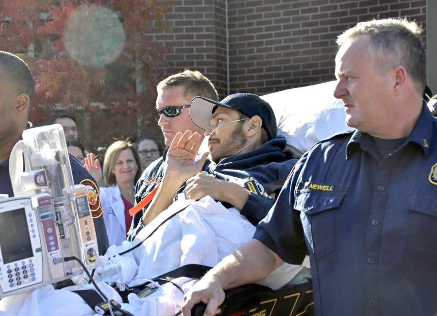 news article fireman gets escort from hospital home