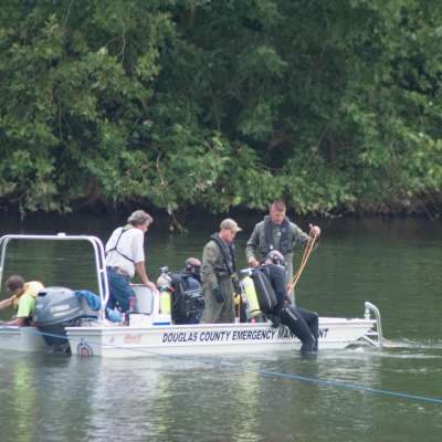 Divers continue search for missing swimmer