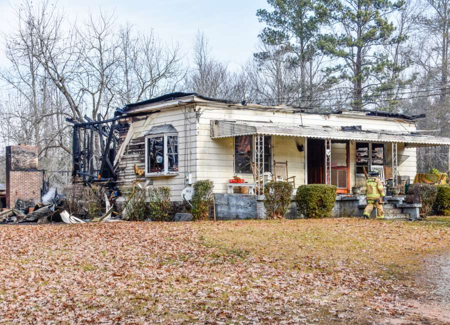 Elderly woman dies in house fire