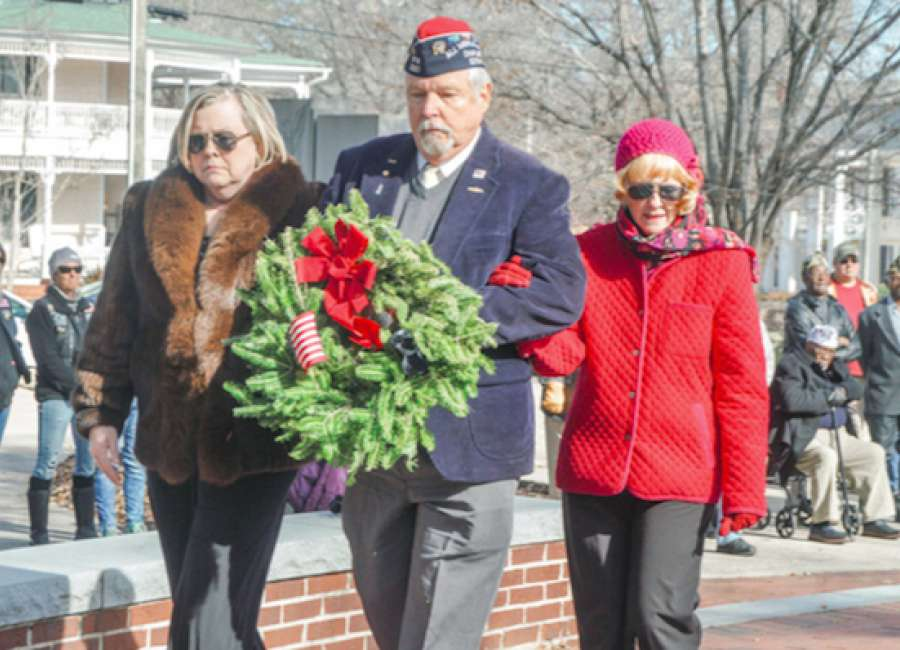 Local veterans honor fallen comrades with wreaths