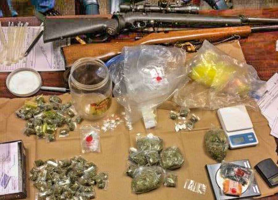 Probation-compliance check leads to seizure of narcotics, weapons