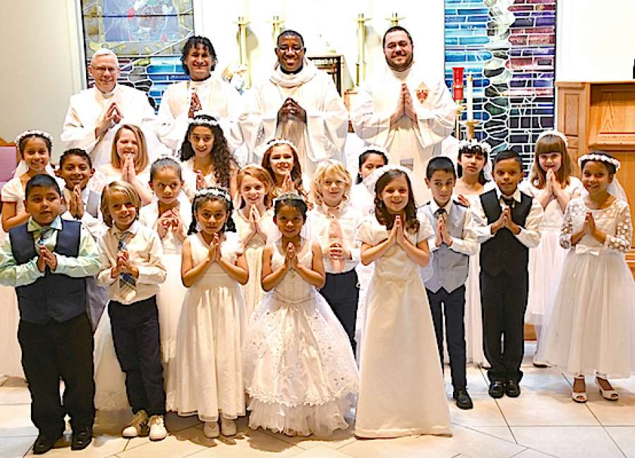 st george children take first communion the newnan times herald