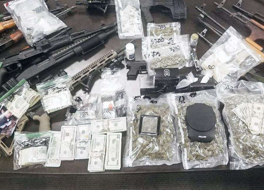 Drugs, guns and $55,000 seized from Senoia home