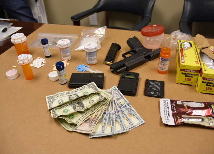 Drugs, guns and cash seized from two Coweta homes