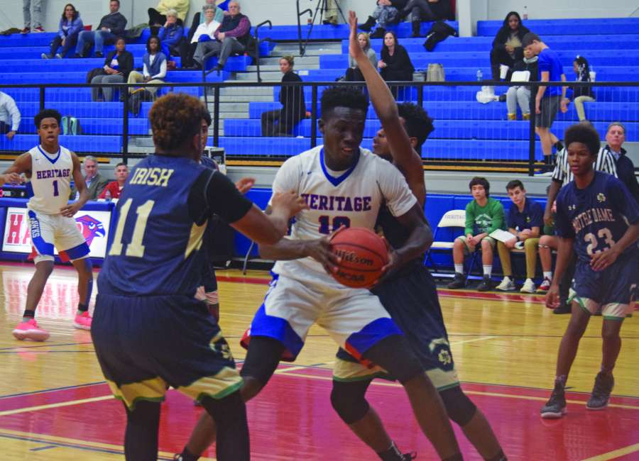 Heritage boys roll past Notre Dame