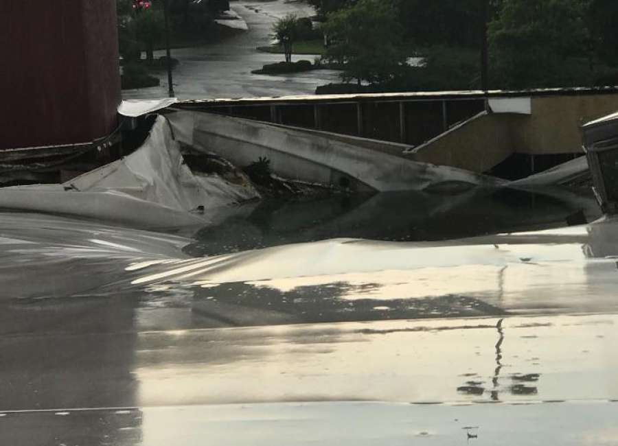 Storm damages roof of local bowling alley