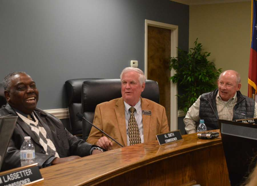 Poole new commission chairman; Smith honored